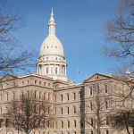 Lansing's Capitol Building during Winter. Photo by Phillip-Hofmeister 2004 via Wikimedia.